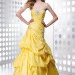 Dugačka žuta haljina bez rukava sa niskim strukom
