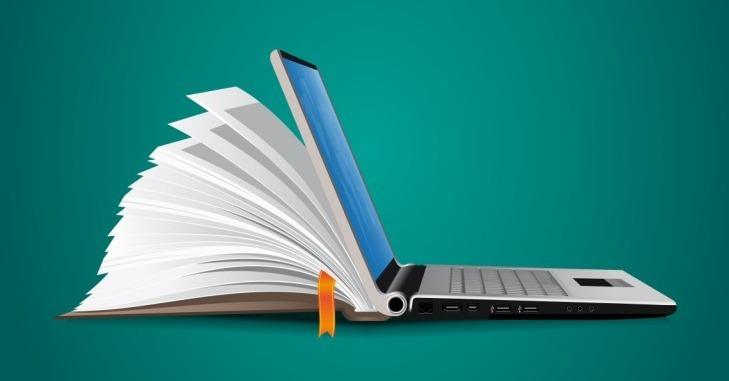 Proces digitalizacije - knjiga i laptop